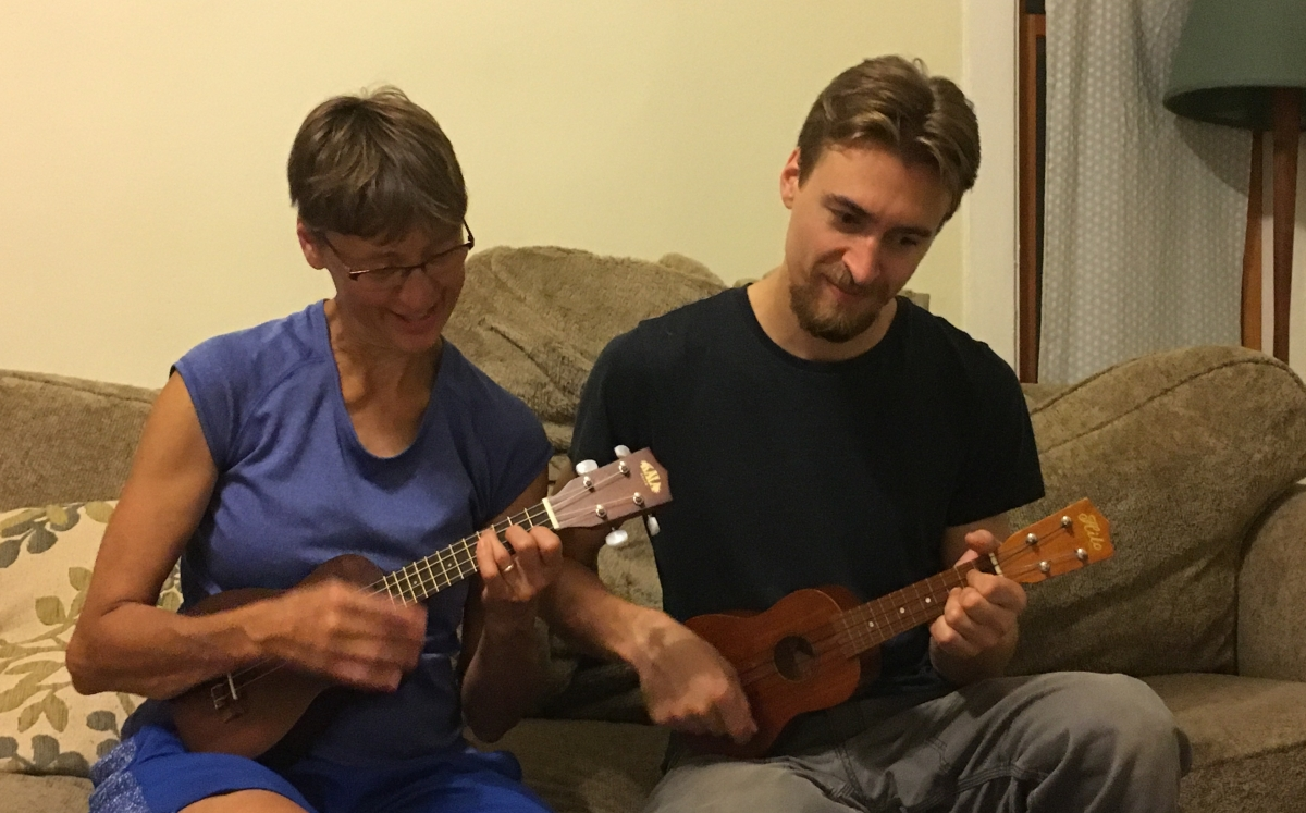 Somewhere over the rainbow head in the clouds learning to strum ukulele chords to israel kamakawiwooles song over the rainbow trying to capture the beauty of his song mom and son violinists hexwebz Gallery
